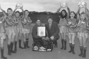 Overdale School was presented with new football equipment for the schools use in December 1995 by Ian Kerr, football community development officer.