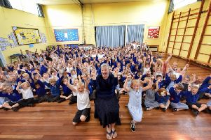 Staff and pupils cheer and wish Mrs Hoggarth good luck. PIC: Richard Ponter