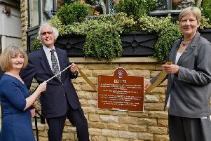 Victor Wild, the 96-year-old nephew of the founder of Bettys, unveils the Harrogate Civic Trust plaque outside the town centre tearooms with chairman Lesley Wild and long serving colleague Dawn Taylor, left, whose has 38 years service.