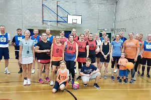 The boys and girls teams line up before the charity netball match.