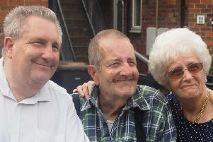 An emotional reunion: Michael Jaques with his brother Derek and sister Dot. Picture: Ashley Blackett.