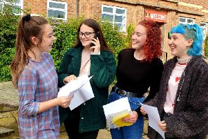 Megan Trenham, Emma Phipps, Megan Ward and Lucy Curtis discuss their results at Scarborough Sixth form College this morning