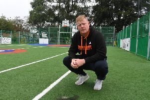 Stewart Boocock standing over burnt artificial pitch on Coronation Rec at the Devonshire Recreation Grounds