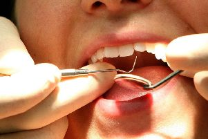 Generic stock picture of a dentist at work.