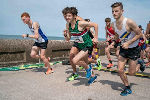 Winner Adam Sciacca (centre, in green) in the Promenade 10-mile race                                                          Picture: MICHAEL HALL