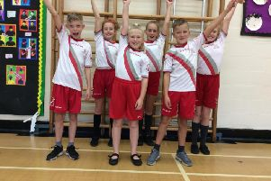 Students from Earby Springfield Primary School celebrate their sports award.