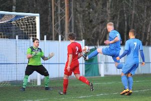 Alec Denton nets for Rossington Main in the derby with Armthorpe Welfare