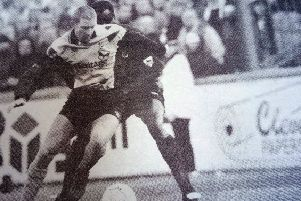 Goalscoring hero Andy Saville shields the ball from Palace player Eric  Young.