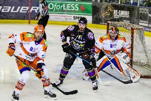Aaron Johnson and Jackson Whistle defend against Manchester