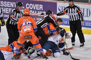 Eric Neiley gets stuck in against Guildford