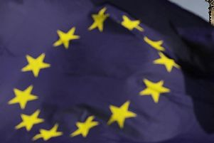 An EU flag flies in the face of Parliament