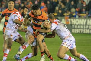 Jesse Sene-Lefao on a strong drive for Castleford Tigers against Catalans Dragons. Picture: Simon Hall