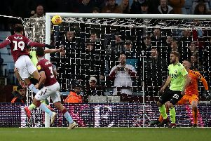 Aston Villa's Andre Green (left) scoring his side's third goal of the game during the Sky Bet Championship match at Villa Park, Birmingham. Nick Potts/PA Wire.