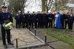 The Bridlington Lifeboat crew at the memorial in the Priory Church yard.