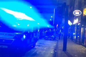 A woman escaped with minor injuries after being struck by a tram on West Street in Sheffield