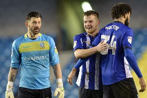Another clean sheet for Owls keeper Keiren Westwood pictured with Jordan Thorniley and Michael Hector at the final whistle. Pic Steve Ellis.