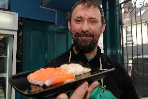 Christian Szurko, of JH Mann Fishmongers, Sharrow Vale Road, with a scallop and salmon platter.
