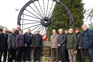 Members of Cadeby Main Colliery Memorial Group, pictured by the Pit Wheel memorial. Picture: NDFP-05-02-19-CadebyColliery-1