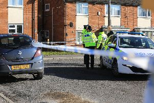 Police officers on Cedric Crescent in Thurcroft today. Picture: Chris Etchells