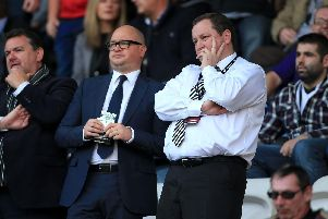 Newcastle United owner Mike Ashley (right) flanked by Lee Charnley.