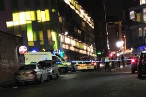 Emergency services on Rockingham Street in Sheffield city centre, where three men were injured in a fight during the early hours of this morning