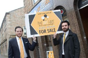 Luke Robinson and Matthew Hargreaves with The Bee Hives new-look board. (s)