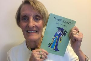 Author Joyce Davis with her book The Magical Mystery Book, 1 The Quest.