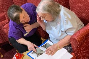 Jessie and Jo enjoy sharing the book about Arbourthorne