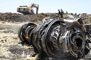 A photo shows debris of the crashed airplane of Ethiopia Airlines, near Bishoftu, a town some 60 kilometres southeast of Addis Ababa, Ethiopia, on March 11, 2019. - Airlines in Ethiopia, China and Indonesia grounded Boeing 737 MAX 8 jets Monday as investigators recovered the black boxes from a brand-new passenger jet that crashed outside Addis Ababa a day earlier, killing all 157 people on board. Photo:  MICHAEL TEWELDE/AFP/Getty Images