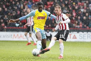 Semi Ajayi of Rotherham tackles Mark Duffy of Sheffield United