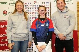 Bridlington Schools Cerys Reece receives the new school kit from England internationals Zoe Aldcroft and Sam Underhill