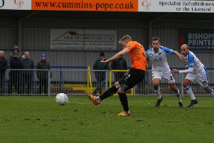 Scott Boden nets the winning goal from the penalty spot.