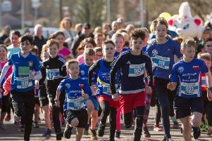 Excited youngsters at the start of last year's junior fun run.