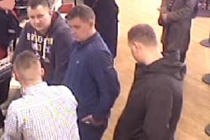 A CCTV image of men police are keen to speak to.