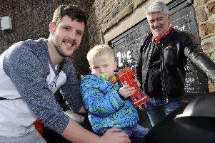 Fundraising Event for youngster Jack Lacey at the Wadsley Jack Pub,Wisewood.Pictured is Jack trying out a seat on a motor-bike with his dad Wesley.........Pic Steve Ellis