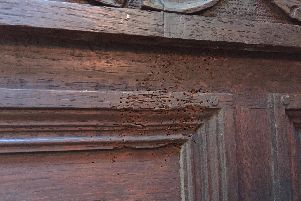 Dart marks on panelling at Carbrook Hall, which is being restored (pic: Sean Fogg)