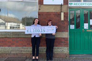 Futaba-Tennecohanded over a cheque for 1,100.15 to Pendleside Hospice