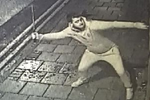 A man is wanted by the police after a Barnsley pub was vandalised