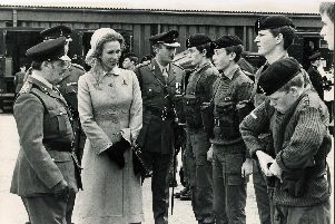 Last minute adjustments by one harassed cadet as Princess Anne inspects her troops at the Manor TA Centre, Sheffield, 1980