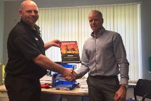 Sean Hale (left) with Yorkshire Housing homeworks delivery manager Andy Kelham at an awards presentation.
