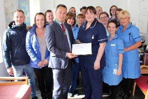 Midwife Sister Rebecca White (centre) receives the Employee of the Month Award from Chief Executive Kevin McGee, surrounded by Birth Suite colleagues alongside (left) Simon and Carla Thompson.