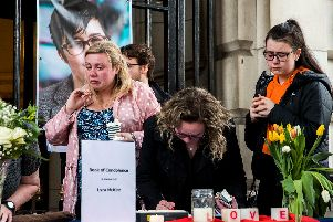 People signing a book of condolence after a vigil at Belfast City Hall in memory of murdered journalist Lyra McKee (pic:  Liam McBurney/PA Wire)