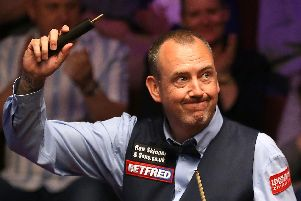 Mark Williams celebrates his victory over Martin Gould during day one of the 2019 Betfred World Championship at The Crucible, Sheffield (pic: Nigel French/PA Wire)