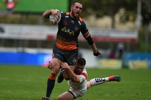 Castleford Tigers' Daniel Smith tries to break clear for Castleford Tigers against Catalans Dragons. Picture: Matthew Merrick