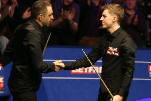 James Cahill is congratulated on his victory by world number one Ronnie O'Sullivan