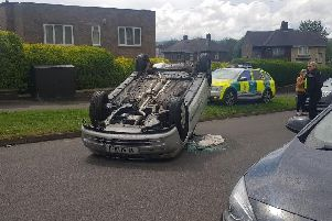 A car overturned and landed on its roof in Parson Cross this afternoon
