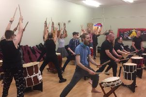 A Taiko drumming workshop in action.
