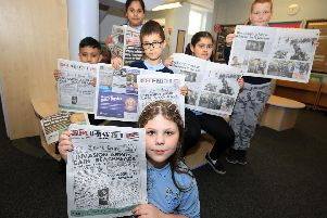 Pupils at Acres Hill Community Primary School with copies of The Star's D-Day supplement. Pictured are Charlie, Polly, Evie, Abdulla, Danyal, and Nabilah.