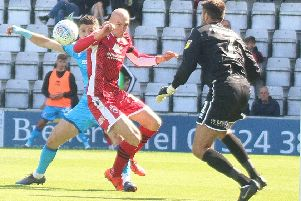 Kevin Ellison was Morecambe's hero with an injury-time equaliser
