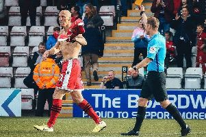 Kevin Ellison scored Morecambe's equaliser against Northampton Town last weekend but earned a yellow card for removing his shirt in celebration